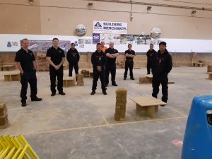 An image of our graduate Building Heroes in the training centre