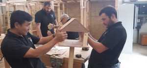 An image of three veterans in training at the Building Heroes Education Foundation