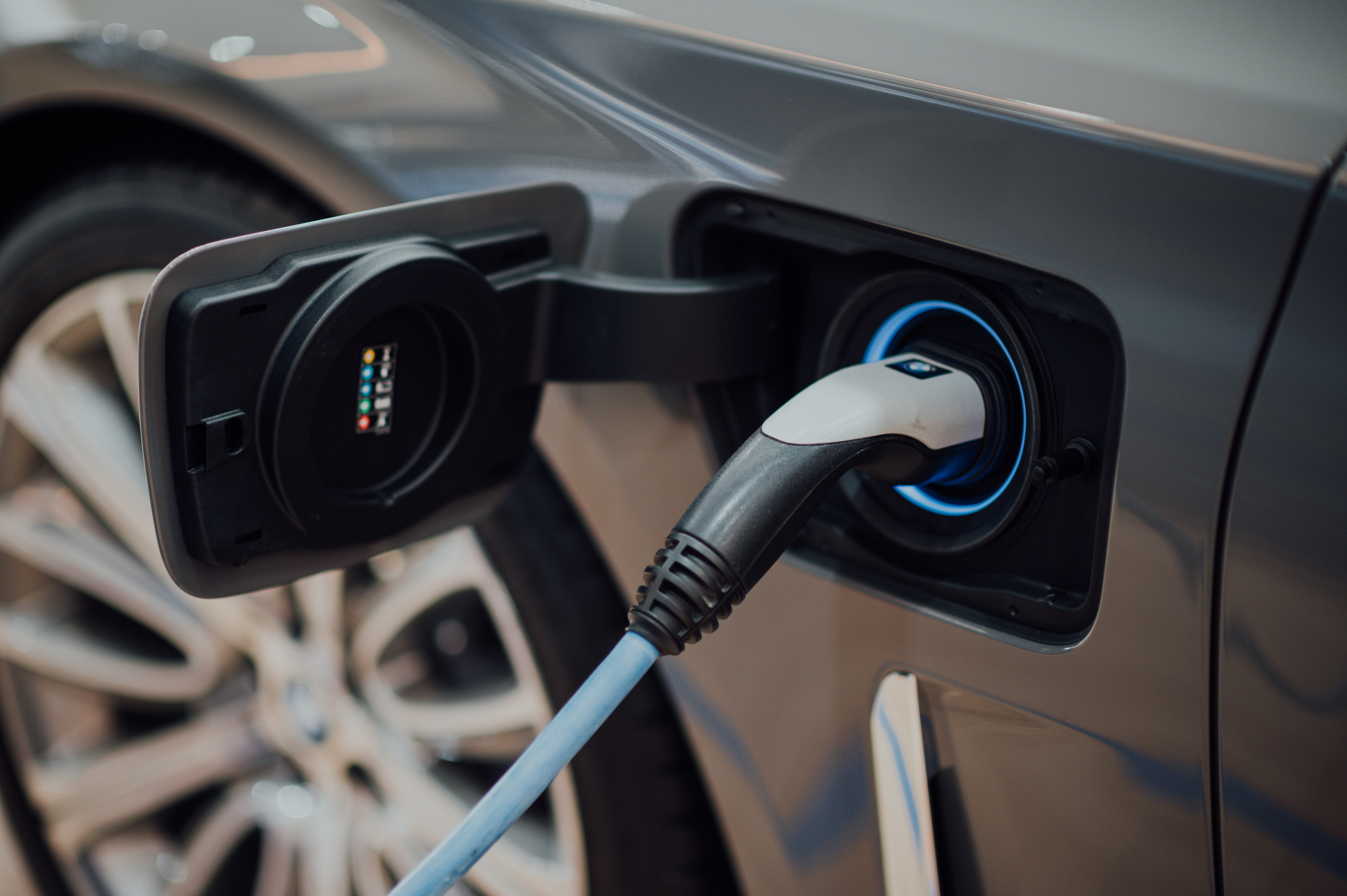 Image of a car hooked up to an EV charger