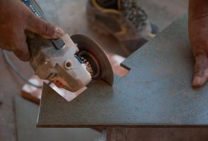 An image of a tile being cut as part of a tiling service